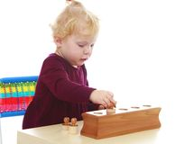 Little girl playing at the table Stock Image