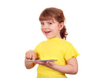 Little girl playing with tablet pc Royalty Free Stock Image