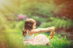 Little girl playing with teddy bear Royalty Free Stock Photos