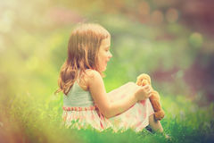 Little girl playing with teddy bear Stock Photography