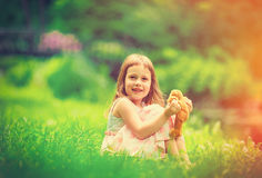 Little girl playing with teddy bear Royalty Free Stock Photography
