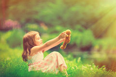 Little girl playing with teddy bear Royalty Free Stock Images