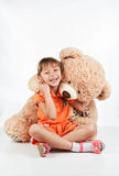 Little girl playing with a teddy bear Royalty Free Stock Image