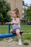 Little girl playing on teeter Stock Photo