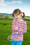 Little girl playing tennis Stock Photography