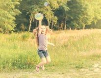 Little girl playing tennis Stock Image