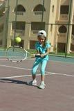 Little girl playing tennis Stock Photo