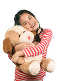 Little girl,playing together with a doll, on white background. Stock Images
