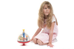 Little girl playing with toy. Shot of little girl playing with toy in studio Royalty Free Stock Photo