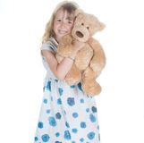 Little girl playing with toy. Shot of little girl playing with toy in studio Royalty Free Stock Photos
