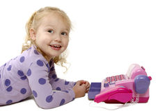 Little girl playing with toy Royalty Free Stock Photos