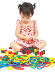 Little girl playing with toy Stock Photo
