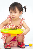 Little girl playing with toy Royalty Free Stock Images