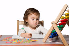 Little girl playing with toy abacus Stock Photo