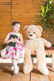 Little girl playing with toy bear outside Royalty Free Stock Photos