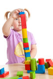 Little girl playing with toy blocks Stock Photography