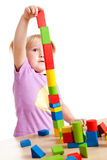 Little girl playing with toy blocks Royalty Free Stock Photo