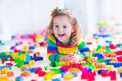 Little girl playing with toy blocks Royalty Free Stock Photography
