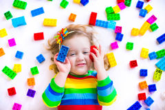 Little girl playing with toy blocks Royalty Free Stock Images