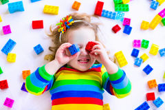 Little girl playing with toy blocks Stock Image
