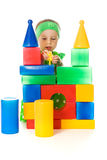 Little girl is playing with toy cubes Royalty Free Stock Image
