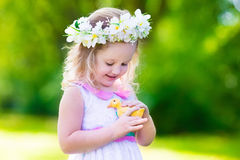 Little girl playing with a toy duck Royalty Free Stock Images
