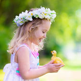 Little girl playing with a toy duck Royalty Free Stock Photography