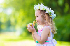 Little girl playing with a toy duck Stock Photography