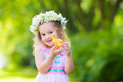 Little girl playing with a toy duck Royalty Free Stock Photo