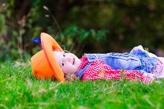 Little girl playing with toy horse in cowboy costume. Little girl dressed up as cowgirl playing with toy rocking horse in park. Kids play cowboy outdoors Stock Photos
