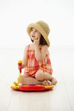 Little girl playing with toy instrument Royalty Free Stock Photography