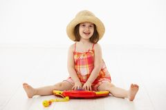 Little girl playing with toy instrument Stock Images