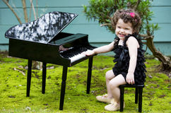 Little girl playing on toy piano Royalty Free Stock Photography