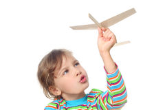 Little girl playing with toy plane royalty free stock photography