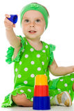 Little girl is playing with toy pyramid Stock Photo