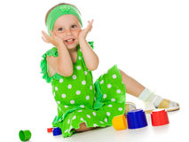 Little girl is playing with toy pyramid Stock Photos