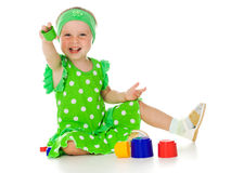 Little girl is playing with toy pyramid Stock Image