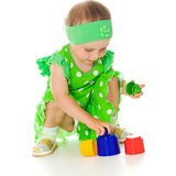 Little girl is playing with toy pyramid Stock Photography