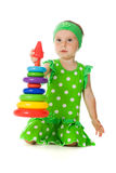 Little girl is playing with toy pyramid Royalty Free Stock Photo