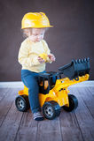 Little Girl Playing with Toy Truck Stock Image