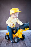 Little Girl Playing with Toy Truck Stock Photos