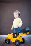 Little Girl Playing with Toy Truck stock photography