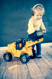 Little Girl Playing with Toy Truck royalty free stock photography