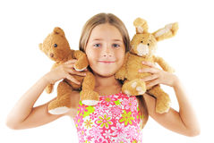 Little girl playing with toys. On white background Stock Image