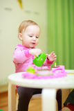 Little girl playing with toys Stock Image