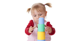 Little girl playing with toys Royalty Free Stock Image