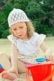 Little girl playing with toys Royalty Free Stock Photography