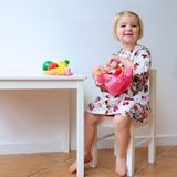 Little girl playing with toys Royalty Free Stock Images