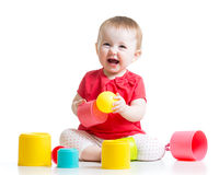 Little girl playing with toys Stock Images