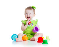 Little girl playing with toys Royalty Free Stock Photos